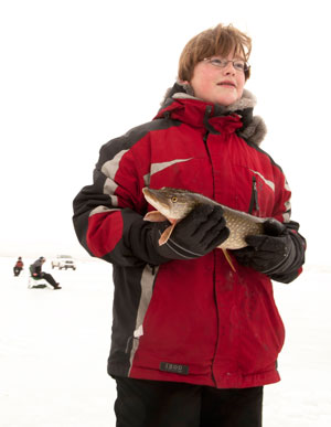 Eric Artz carries his catch to the kitchen area, where dinner is about to be served.