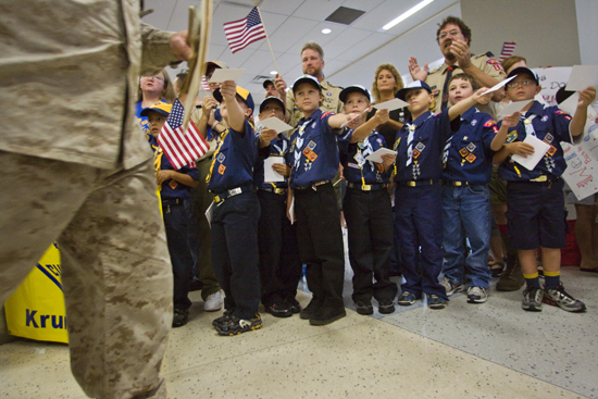 Pack 136, Krum TX greets returning service personnel returning from Iraq, at DFW Airport.
