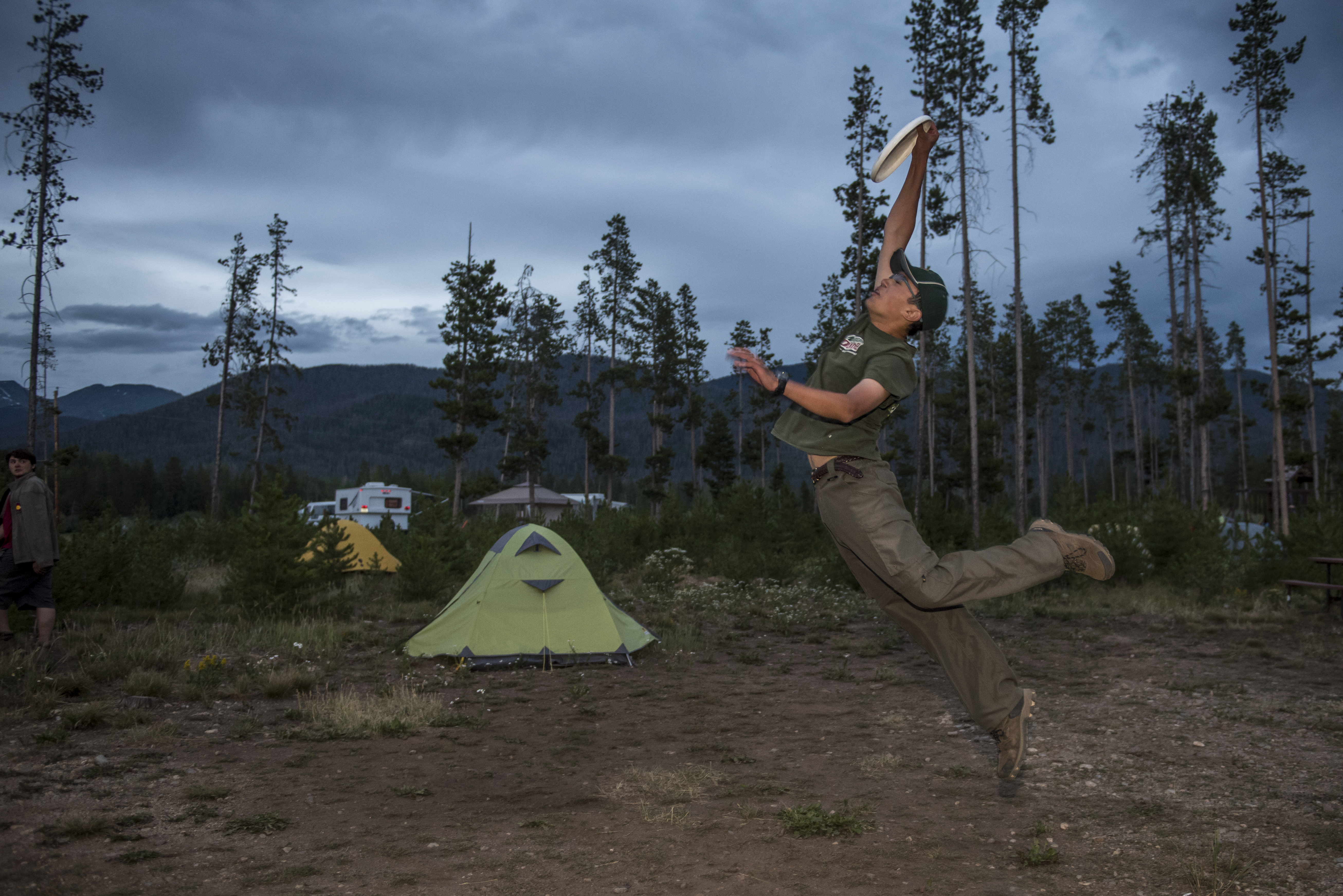 Scouts from PA eat  and do evening activities at a campground on the the edge of Rocky Mountain National Park,  Colorado.