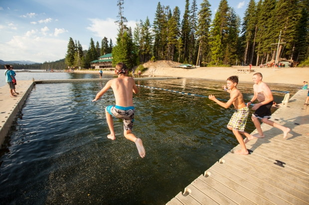 Boy Scouts leaping into Payette Lake at Camp Morrison's Waterfront facility.