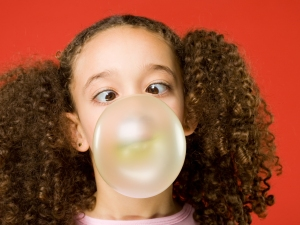 Little girl blows a big bubble