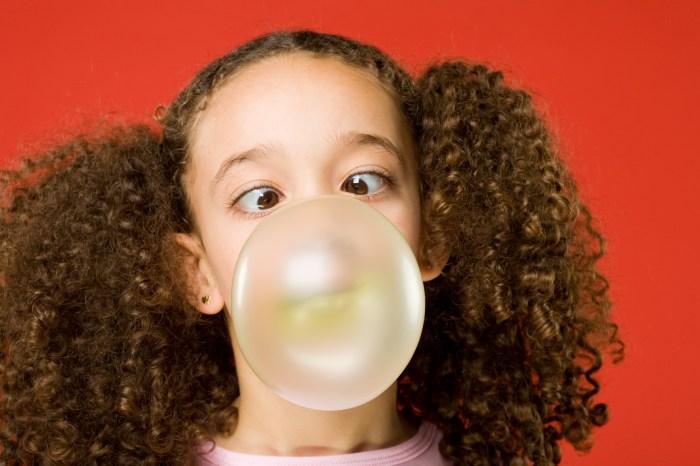 Little girl blows a big bubble